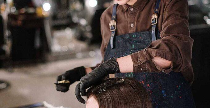 two woman hair wash in salon
